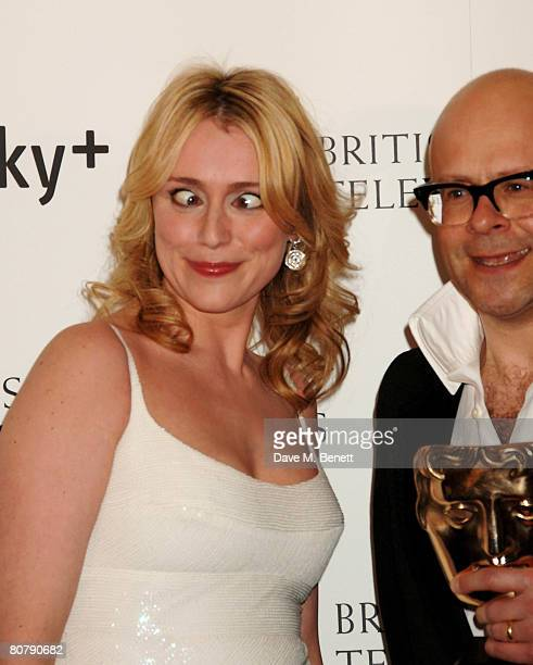 Keeley Hawes pose in front of the winners boards with Harry Hill with his award for Best Entertainment Programme for Harry Hill the British Academy...