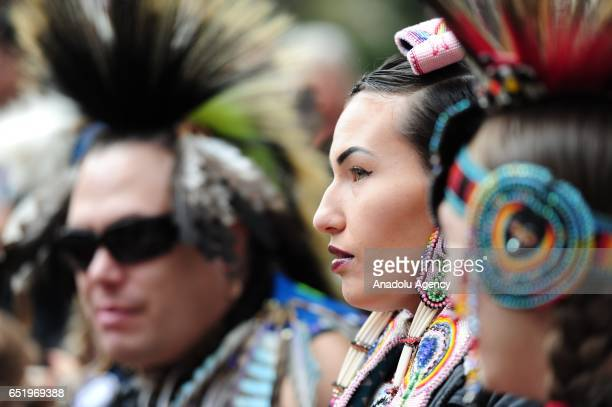 Keeli Little Leaf from the Warm Springs tribe takes part in a protest standing in solidarity with the 'Native Nations Rise' march on Washington DC...