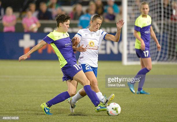 Keelin Winters of Seattle Reign FC and Mandy Laddish of FC Kansas City battle for a ball during the second half of the game at Providence Park on...