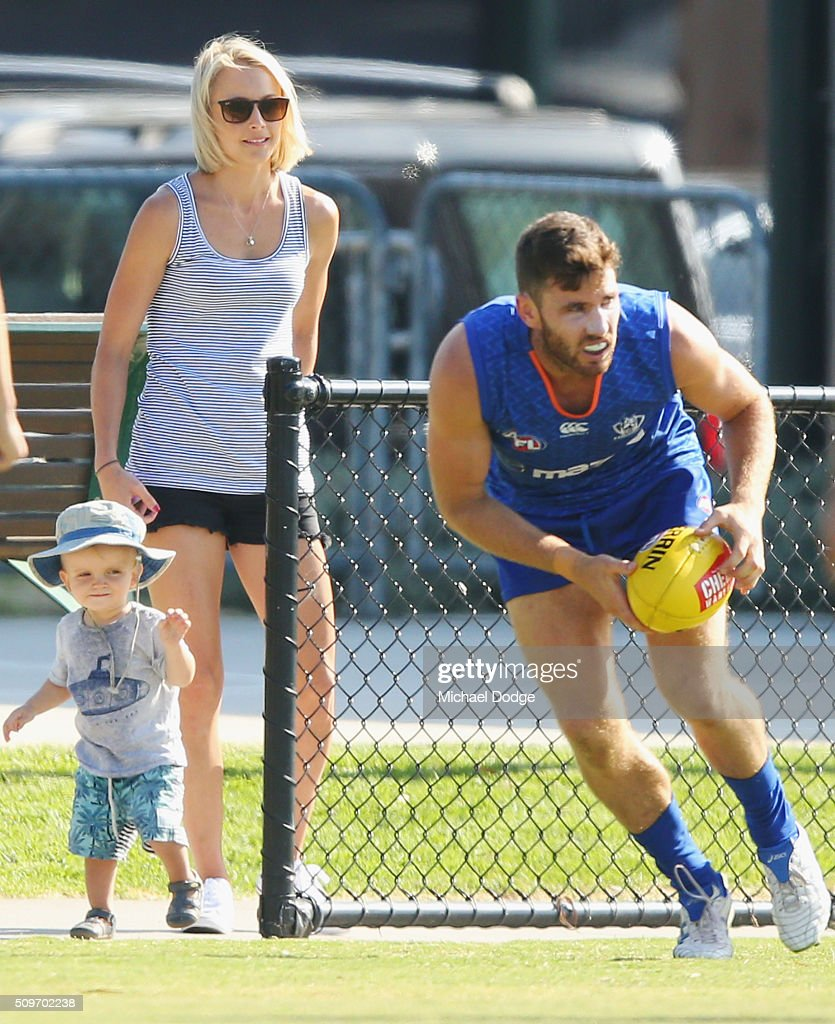 A keen Kangaroos fan get close to the action during the North Melbourne AFL Intra-Club match at Arden Street Ground on February 12, 2016 in Melbourne, Australia.