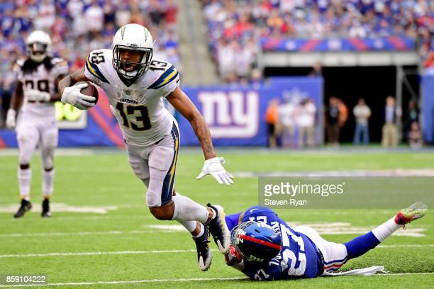 Keenan Allen of the Los Angeles Chargers escapes the tackle attempt of Darian Thompson of the New York Giants during the fourth quarter during an NFL...
