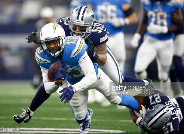 Keenan Allen of the Los Angeles Chargers is tackled by Anthony Hitchens of the Dallas Cowboys and Jourdan Lewis of the Dallas Cowboys in the first...