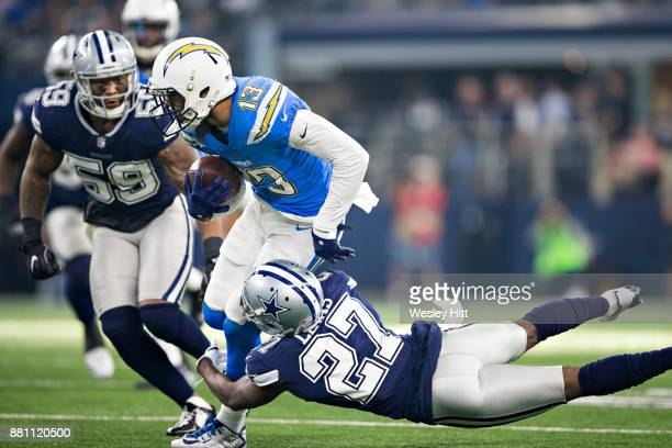 Keenan Allen of the Los Angeles Chargers runs the ball and is tackled by Jourdan Lewis of the Dallas Cowboys at ATT Stadium on November 23 2017 in...