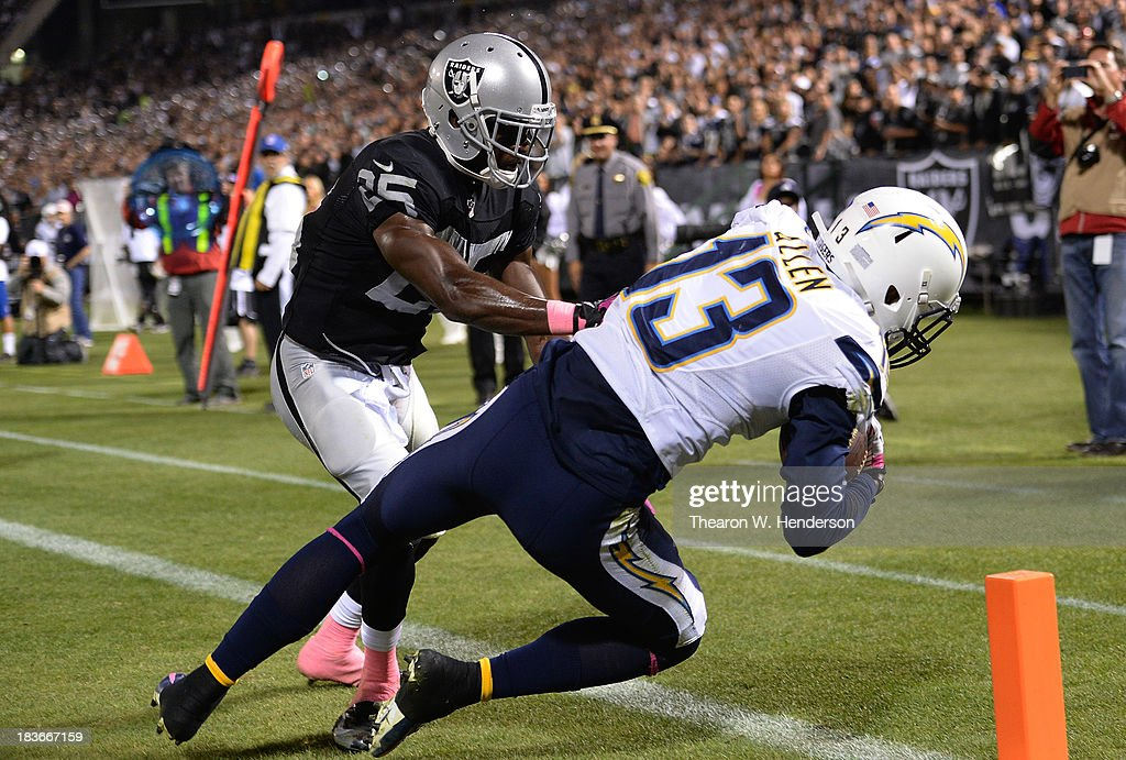 Keenan Allen of the San Diego Chargers catches this pass over DJ Hayden of the Oakland Raiders but it the catches was ruled out of bounds in the back...