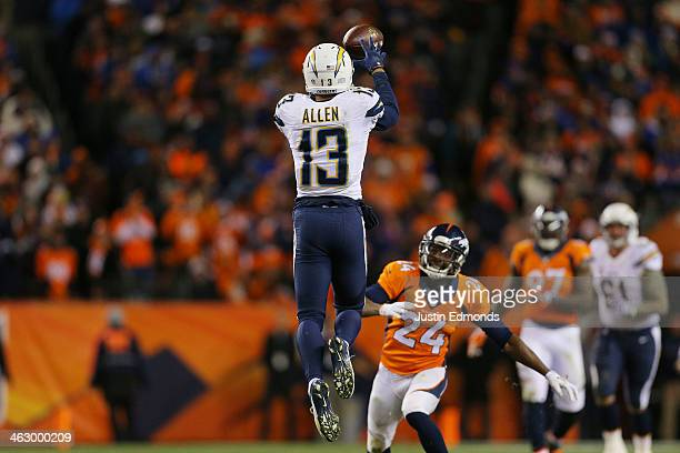 Keenan Allen of the San Diego Chargers completes a reception against the defense of Champ Bailey of the Denver Broncos during the AFC Divisional...