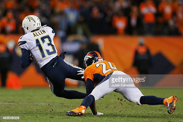 Keenan Allen of the San Diego Chargers is tackled by Champ Bailey of the Denver Broncos during the AFC Divisional Playoff Game at Sports Authority...