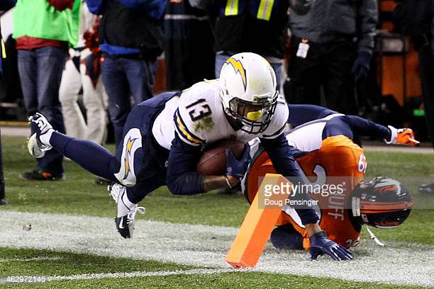 Keenan Allen of the San Diego Chargers scores a fourth quarter touchdown against Michael Huff of the Denver Broncos during the AFC Divisional Playoff...