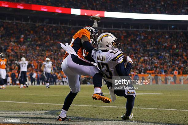 Keenan Allen of the San Diego Chargers scores a second quarter touchdown against the defense of Kayvon Webster of the Denver Broncos at Sports...
