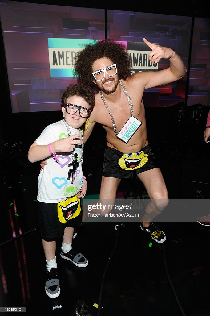 Keenan Cahill and LMFAO Red Foo pose backstage at the 2011 American Music Awards held at Nokia Theatre LA LIVE on November 20 2011 in Los Angeles...