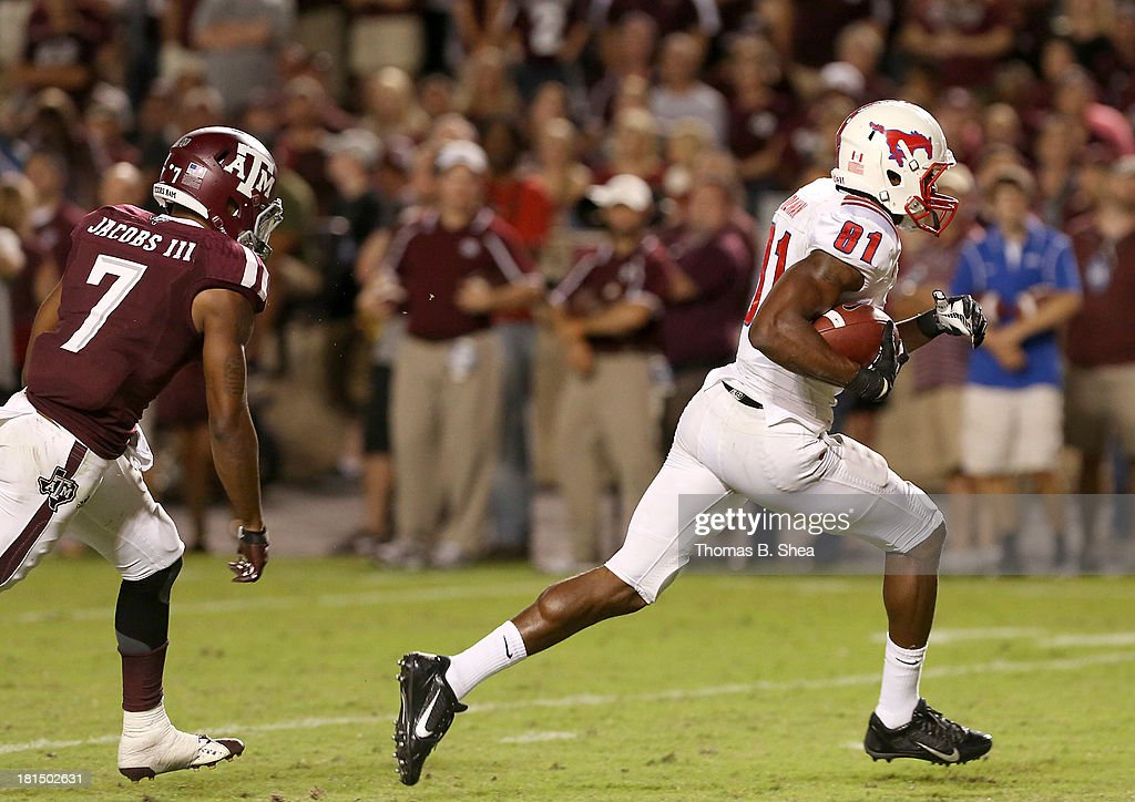 Keenan Holman #81 of the Southern Methodist Mustangs scores a reception touchdown as he runs away from Tramain Jacobs #7 of the Texas A&M Aggies in the second half on September 21, 2013 at Kyle Field in College Station, Texas.
