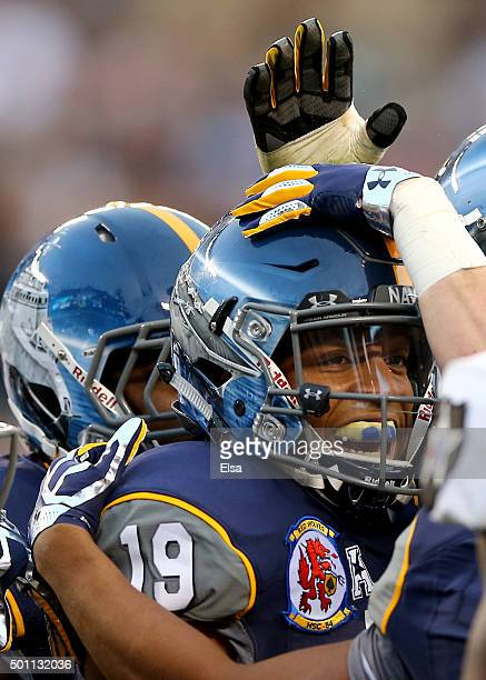 Keenan Reynolds of the Navy Midshipmen is congratulated after his touchdown in the second quarter against the Army Black Knights at Lincoln Financial...