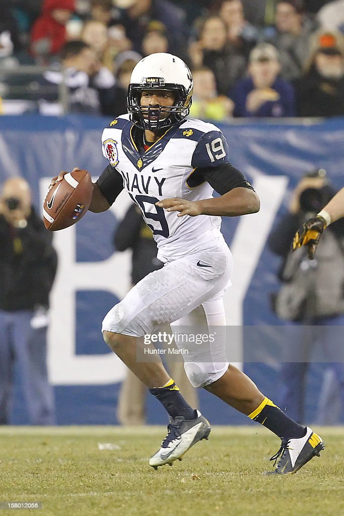 Keenan Reynolds #19 of the Navy Midshipmen rolls out of the pocket during a game against the Army Black Knights on December 8, 2012 at Lincoln Financial Field in Philadelphia, Pennsylvania. The Navy won 17-13.