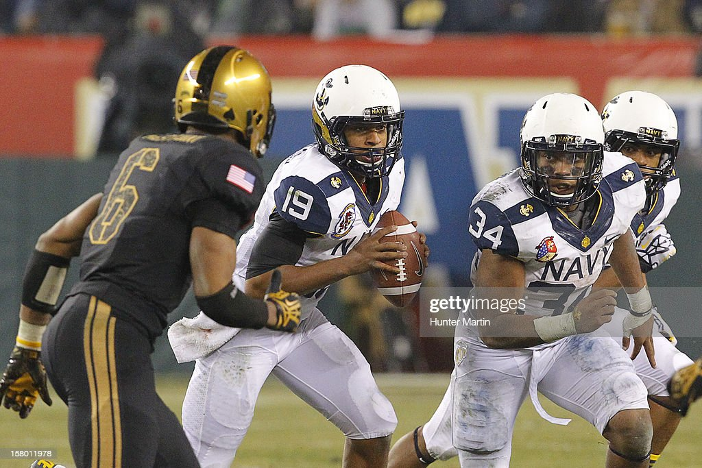 Keenan Reynolds #19 of the Navy Midshipmen runs with the ball during a game against the Army Black Knights on December 8, 2012 at Lincoln Financial Field in Philadelphia, Pennsylvania. The Navy won 17-13.