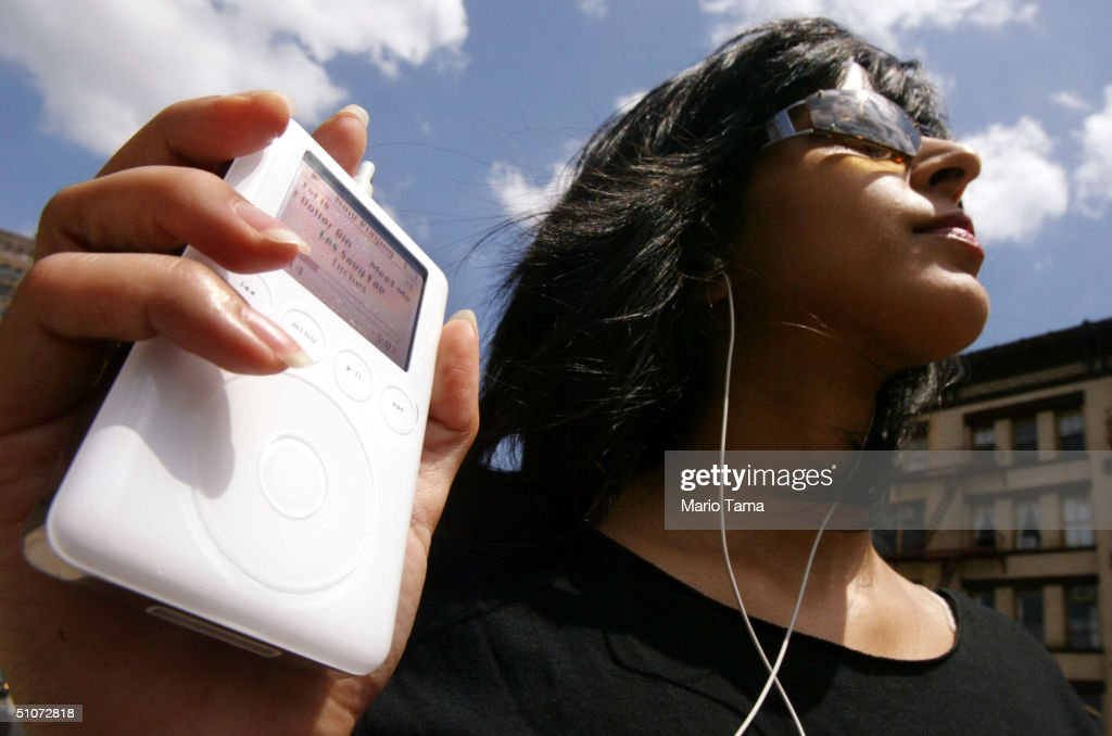 Keeno Ahmed listens to her iPod mini digital music player July 15 2004 in New York City Apple Computer Inc reported quarterly earnings that more than...