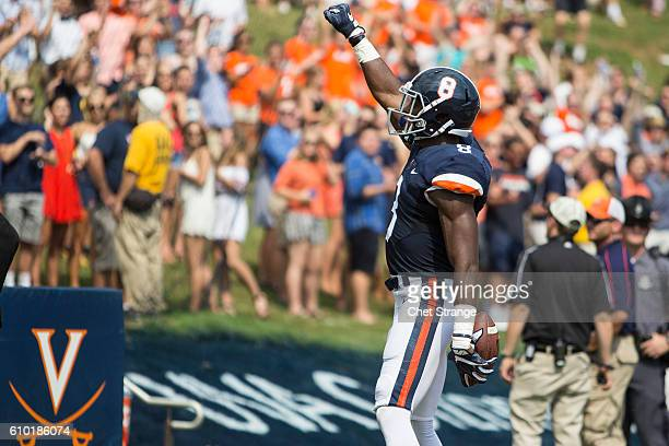 Keeon Johnson of the Virginia Cavaliers raises his fist after scoring a touchdown during Virginia's game against the Central Michigan Chippewas at...