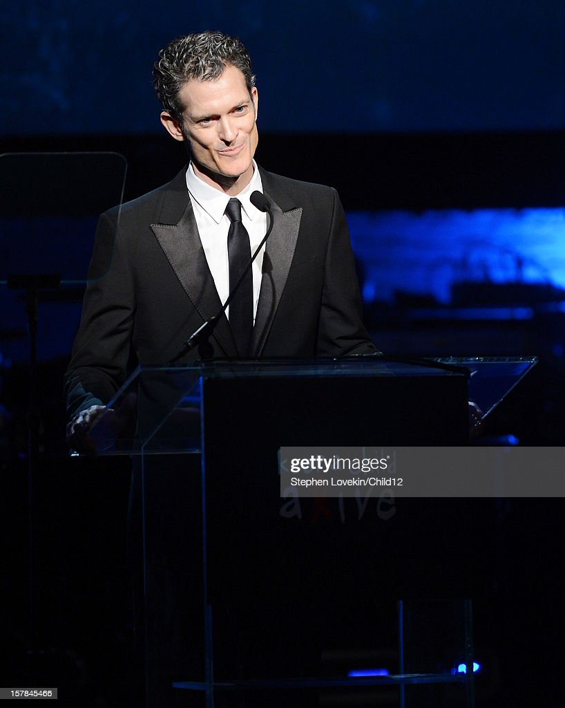 Keep A Child Alive CEO Peter Twyman speaks on stage during Black Ball Redux at The Apollo Theater on December 6, 2012 in New York City.