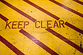 Keep clear warning stripes painted on floor