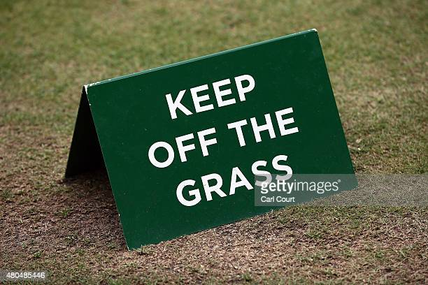 A 'Keep Off The Grass' sign is pictured on Centre Court on day 13 of the Wimbledon Lawn Tennis Championships at the All England Lawn Tennis and...