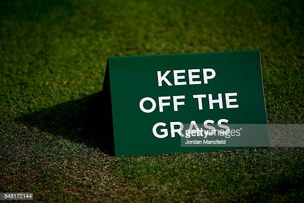 Keep Off The Grass Sign sits on Centre Court ahead of the start of play on day nine of the Wimbledon Lawn Tennis Championships at the All England...