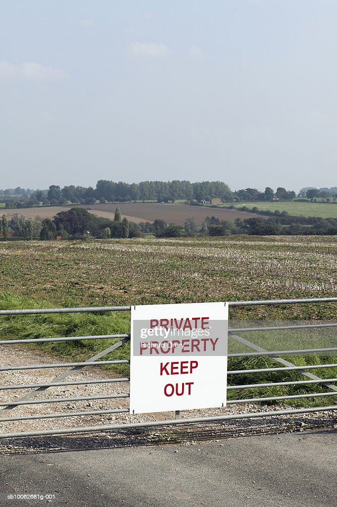 Keep Out sign on fence in field