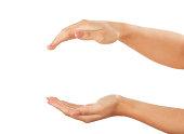 female hands holding up something on whitekeep something between women hands on white