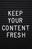 The phrase Keep Your Content Fresh in white plastic letters on a letter board as a reminder to update your marketing and social media platforms