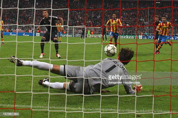 Keeper Diego Alves of Valencia safes a penalty shot by Mario Mandzukic of Muenchen during the UEFA Champions League group F match between FC Bayern...
