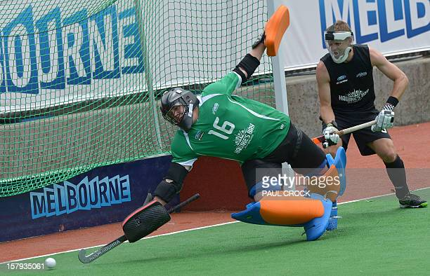 Keeper Hamish McGregor of New Zealand unsuccessfully attempts to stop the ball as Germany scores off a penalty corner during their match at the men's...