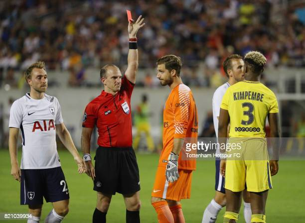 Keeper Kevin Trapp of Paris SaintGermain is issued a red card at the start of the second half of their match with Tottenham Hotspur during a...