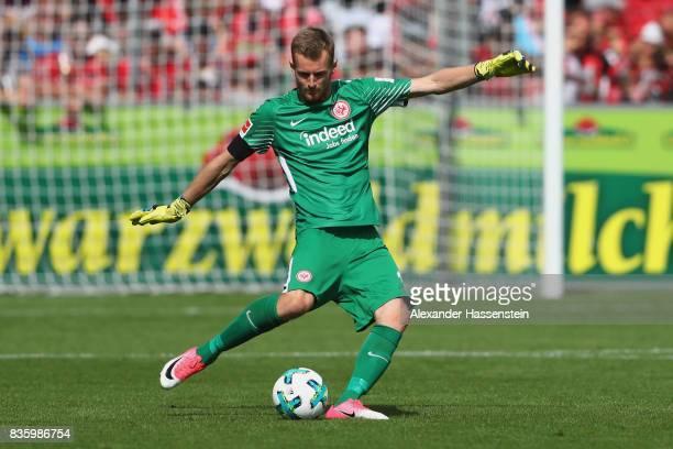 Keeper Lukas Hradecky of Frankfurt runs with the ball during the Bundesliga match between SportClub Freiburg and Eintracht Frankfurt at...