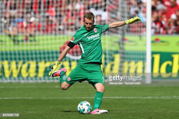 Keeper Lukas Hradecky of Frankfurt runs with the ball during the Bundesliga match between SportClub Freiburg and Eintracht Frankfurt at...