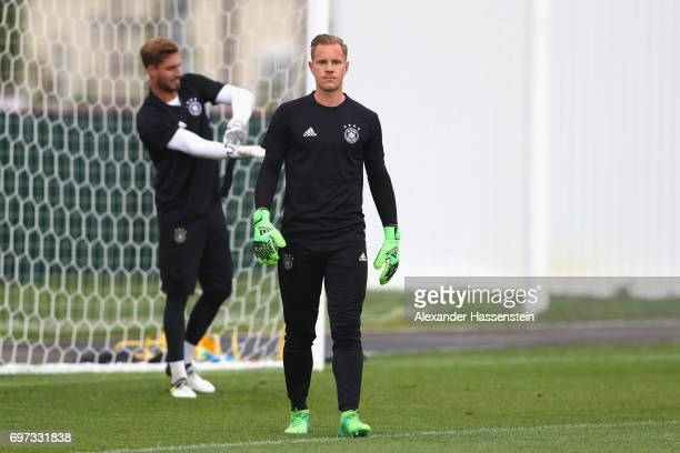 Keeper MarcAndre ter Stegen looks on next to his team mate Kevin Trapp during a team Germany training session at Park Arena training ground on June...