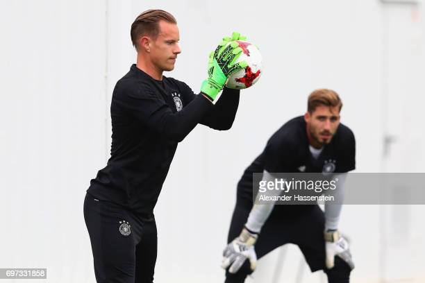 Keeper MarcAndre ter Stegen safes the ball next to his team mate Kevin Trapp during a team Germany training session at Park Arena training ground on...