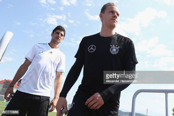 Keeper MarcAndre terStegen of Germany arrives with his team mate Lars Stindl for a mixed zone press conference prior to a team Germany training...