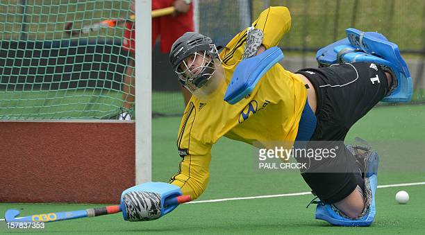 Keeper Nicolas Jacobi of Germany makes a dive for a ball during a training session for the Men's Hockey Champions Trophy tournament in Melbourne on...