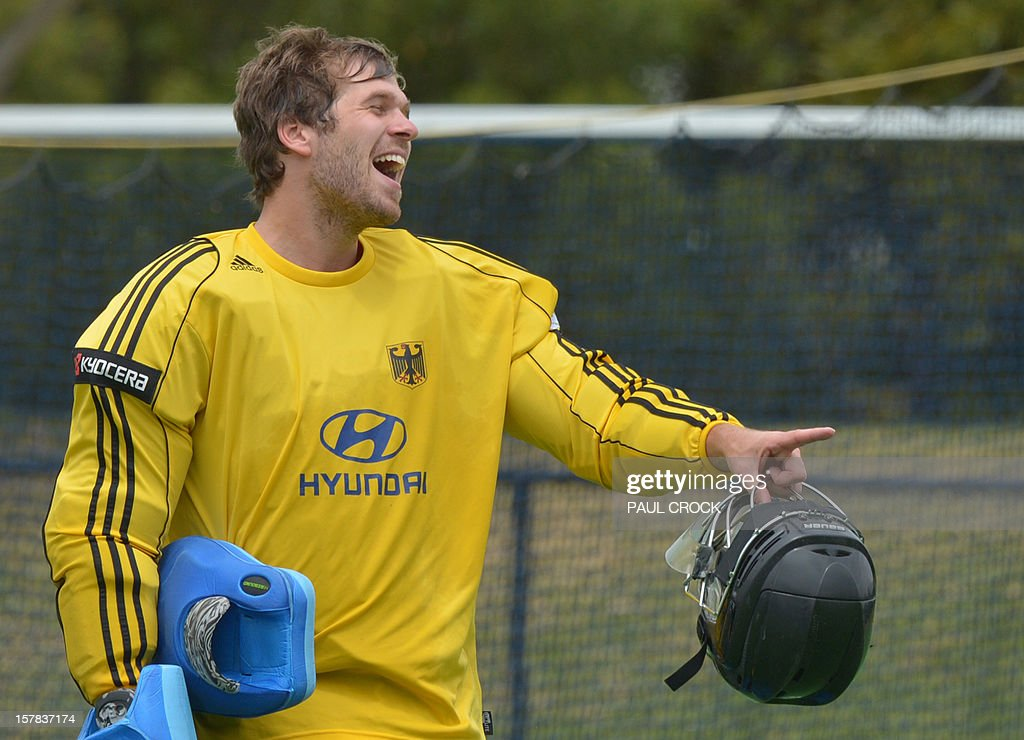 Keeper Nicolas Jacobi of Germany shares a laugh with teammates during a break in a light practice session for the Men's Hockey Champions Trophy tournament in Melbourne on December 7, 2012. IMAGE STRICTLY RESTRICTED TO EDITORIAL USE - STRICTLY NO COMMERCIAL USE AFP PHOTO/Paul CROCK