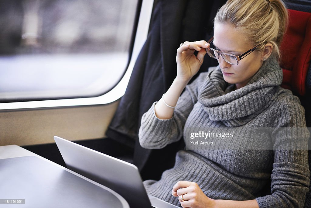Keeping herself busy while she waits for her destination