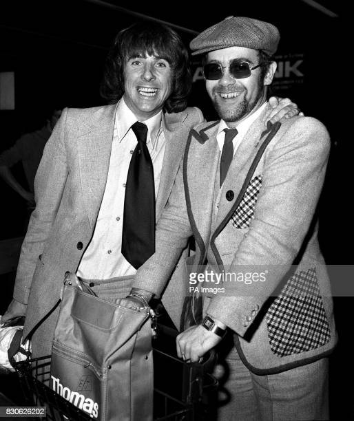 Keeping his chin up after England's defeat at the hands of the Italians England footballer Stan Bowles accompanied by singer Elton John arrives at...