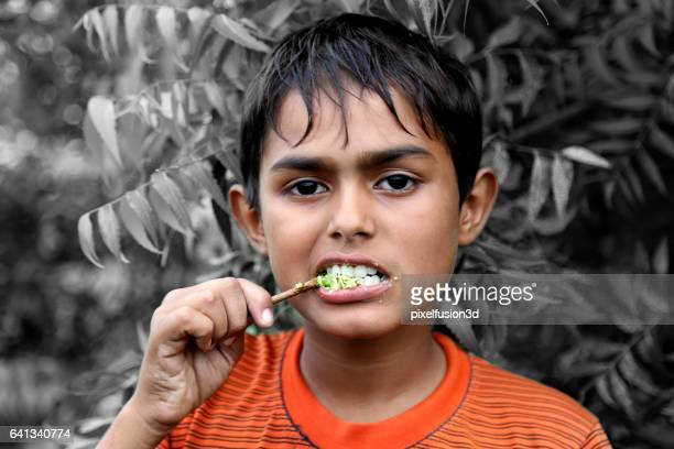 Keeping his teeth clean and healthy using datun
