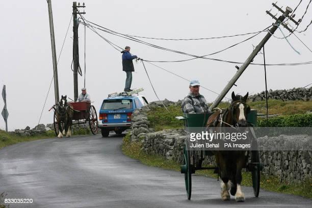 Keeping the lines of communication open on Aran linesman Joe Quinn repairs wind damaged phone lines while Ronan O'Fleabharta heads to the Kilronan...