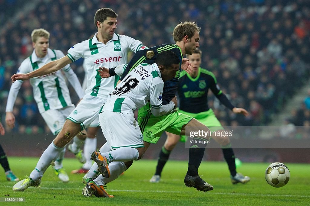 Kees Kwakman of FC Groningen, Lorenzo Burnet of FC Groningen, Christian Eriksen of Ajax during the Dutch Cup match between FC Groningen and Ajax Amsterdam at the Euroborg on December 20, 2012 in Groningen, The Netherlands.