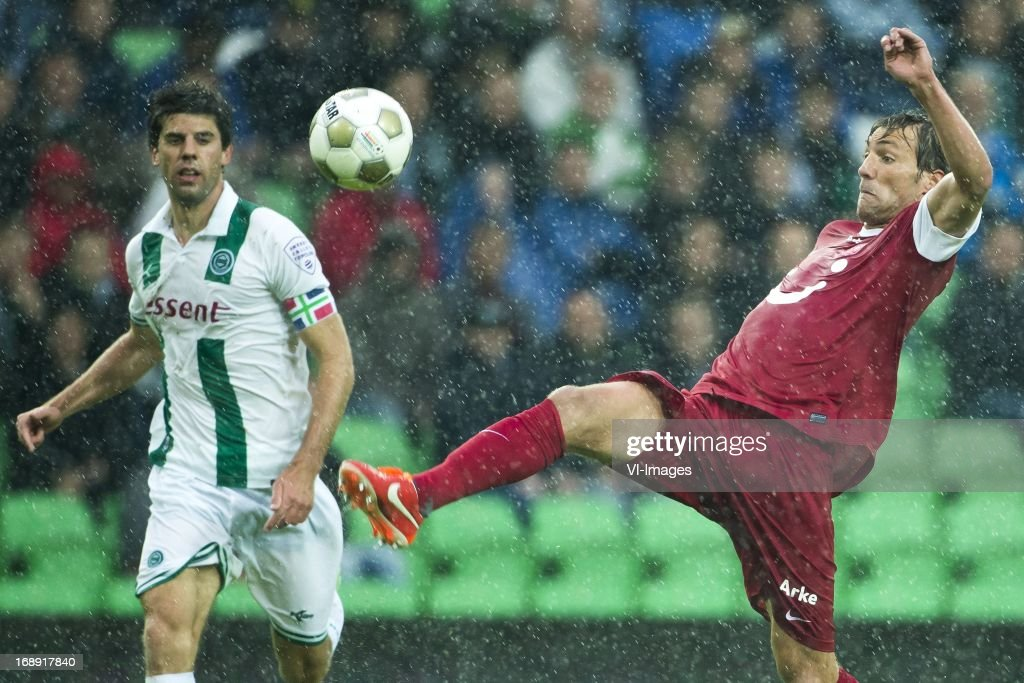 Kees Kwakman of FC Groningen, Willem Janssen of FC Twente during the Eredivisie Europa League Playoff match between FC Groningen and FC Twente on May 16, 2013 at the Euroborg stadium at Groningen, The Netherlands.