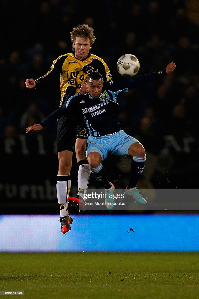 Kees Luijckx of NAC and Tjaronn Chery of Den Haag battle for the header during the Eredivisie match between NAC Breda and ADO Den Haag at the Rat Verlegh Stadium on November 23, 2012 in Breda, Netherlands.
