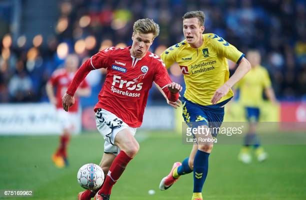 Kees Luijckx of Sonderjyske and Gustaf Nilsson of Brondby IF compete for the ball during the Danish Alka Superliga match between Brondby IF and...