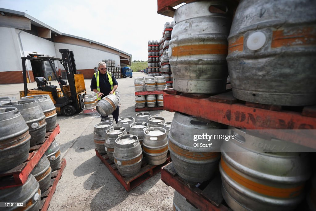 Kegs are stacked outside distribution centre for Adnams brewery on June 25, 2013 in Reydon, England. Established in the small Suffolk coastal town of Southwold in 1872 by George and Ernest Adnams, today their award winning beers are enjoyed throughout the UK and produced with minimum environmental impact in mind. The Suffolk coastline has been the inspiration for many of the names and packaging design of Adnams beer and spirits range. In addition to their core business of brewing beer, Adnams also run hotels, distill a range of spirits, have several drink and kitchenware shops and run guided tours of their brewery.