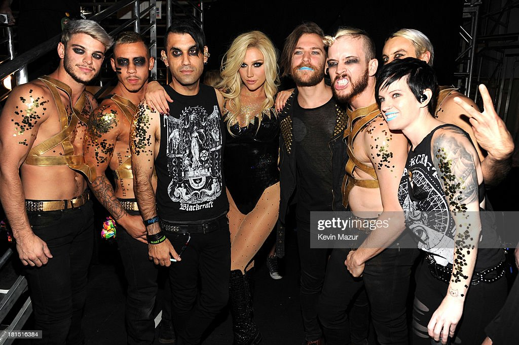 Ke$ha (C) and her band attend the iHeartRadio Music Festival at the MGM Grand Garden Arena on September 20, 2013 in Las Vegas, Nevada.