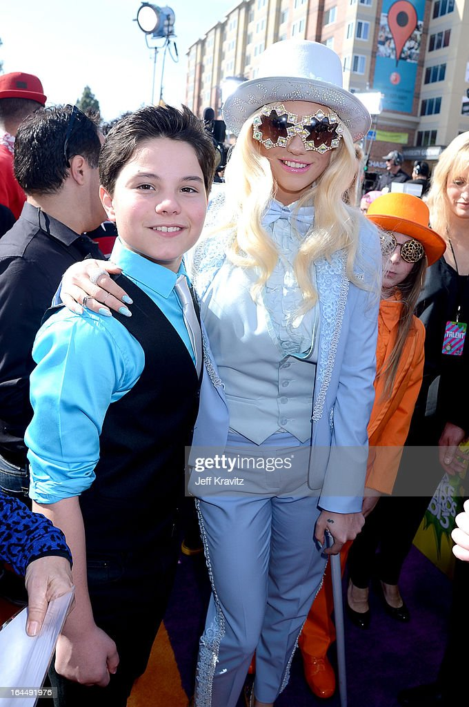 <a gi-track='captionPersonalityLinkClicked' href=/galleries/search?phrase=Ke%24ha&family=editorial&specificpeople=6718222 ng-click='$event.stopPropagation()'>Ke$ha</a> (R) and Zach Callison arrive at Nickelodeon's 26th Annual Kids' Choice Awards at USC Galen Center on March 23, 2013 in Los Angeles, California.