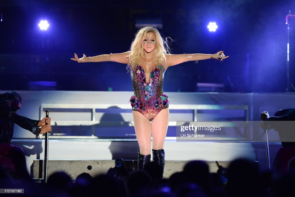 <a gi-track='captionPersonalityLinkClicked' href=/galleries/search?phrase=Ke%24ha&family=editorial&specificpeople=6718222 ng-click='$event.stopPropagation()'>Ke$ha</a> performs at the iHeartRadio Ultimate Pool Party Presented By VISIT FLORIDA At Fontainebleau's BleauLive at Fontainebleau Miami Beach on June 29, 2013 in Miami Beach, Florida.