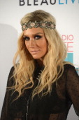 Ke$ha poses backstage at the iHeartRadio Ultimate Pool Party Presented by VISIT FLORIDA at Fontainebleau's BleauLive in Miami featuring live...