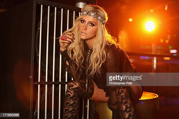 Ke$ha poses in the Wonderwall Portrait Studio at the iHeartRadio Ultimate Pool Party Presented by VISIT FLORIDA at Fontainebleau's BleauLive in Miami...